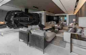 Man Hangs ₦540 Million Super Car From The Ceiling Of His Apartment In U.S (Photos)